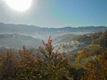 The first winter snow can't withstand the blazing sun over Magura, Pestera and Moieciu in Romania