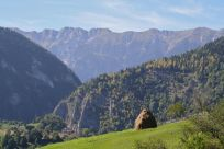 Traditional Transylvanian haystack against the mountainous backdrop