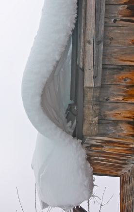 Roof snow hanging on, just